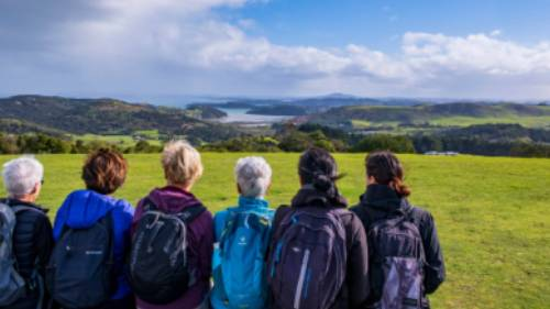 A group of Te Ara Hura walkers stop to take a break and admire the view | Terra and Tide