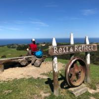 I think it's time to do what the sign says - taking a rest on the Kaikoura Coast Track |  <i>Angela Sexton</i>
