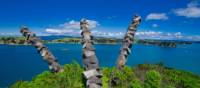 Chris Booth's stunning sculpture, Kaitiaki, leaning out from Rotoroa Island | Terra and Tide