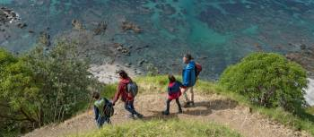 A family out enjoying one of New Zealand's fabulous coastal walks | Fraser Clements